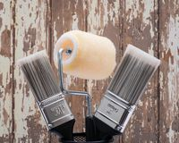 Flat Cut Utility Paint Brushes and High Density Knit Fabric Trim Roller with Frame  on wood. En background stock photography