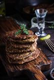 Flat cutlets on chopping board. Stock Photography