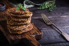 Flat cutlets on chopping board. Stock Images