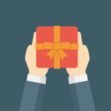 Flat Design Illustration Of Hand Holding Gift Box. Man holding gift box, man giving a gift Royalty Free Stock Images