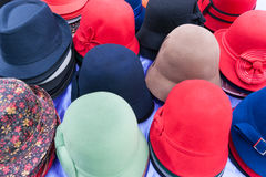 Flat design selection of colored hats Stock Image