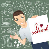 Smiling schoolboy standing in front of a blackboard and holding a poster with phrase `I love school`. Flat design, vector cartoon illustration Royalty Free Stock Image
