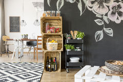 Flat with dining table. Chairs and diy crate storage stock photo