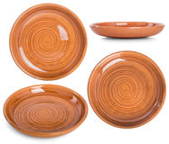 The flat earthenware dish with a spiral pattern. Set photos from Royalty Free Stock Photos