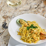 Flat egg noodles with seafood Stock Photos