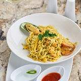 Flat egg noodles with seafood Stock Images