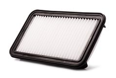 Flat engine air filter in a plastic case royalty free stock image