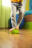 Flat feet correction exercise. Little boy walking over spiked half balance massage balls Royalty Free Stock Images