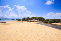 Flat Golden Sand Beach of Sea Bay under Low Tide Stock Images