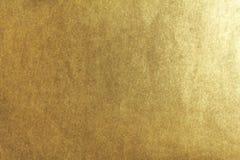 Flat golden texture. Flat and grainy golden texture royalty free stock photo