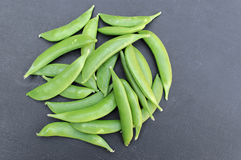 Flat Green Beans on Dark Background Stock Image