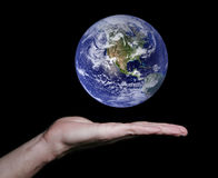Flat Hand With Floating Earth Royalty Free Stock Photo