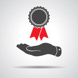 Flat hand giving badge with red ribbons icon Royalty Free Stock Image