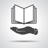 Flat hand giving the book icon Royalty Free Stock Photography