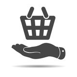Flat hand giving the shopping basket icon Royalty Free Stock Photo