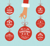 Flat hand holding christmas ball. Set typographic christmas vintage labels made in vector Royalty Free Stock Images