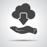 Flat hand showing black cloud computing download icon on a grey Stock Photos