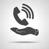 Flat hand showing black phone receiver icon Royalty Free Stock Photos