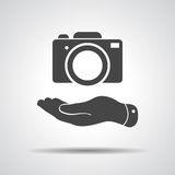 Flat hand shows the photo camera icon Royalty Free Stock Photos