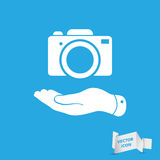 Flat hand shows the photo camera icon Stock Photography