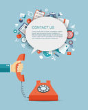 Flat illustration of hand holding phone with icons. Contact us. Stock Photography