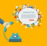 Flat illustration of hand holding phone with icons. Contact us. Royalty Free Stock Photo