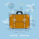 Flat illustration of suitcase against blue background Royalty Free Stock Photos