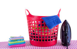 Flat-iron and a laundrey basket Royalty Free Stock Photography
