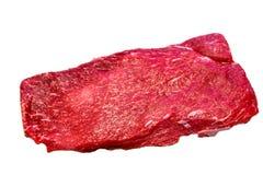 The flat iron steak lies on a white background. royalty free stock photo