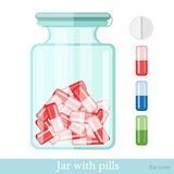 Flat jar of capsule pills and set of different pills  on white Royalty Free Stock Image