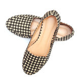 Flat lady's shoes with checkered pattern Royalty Free Stock Images