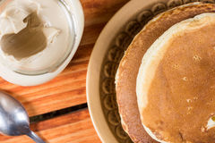 Flat lay above american pancakes with bowl of chocolate cream Royalty Free Stock Photos