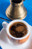 Flat lay above cup of coffee on the blue background table. Flat lay above cup of coffee on the blue background table Stock Photo