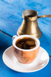 Flat lay above cup of coffee on the blue background table. Flat lay above cup of coffee on the blue background table Stock Photos