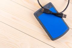 Flat lay above external hard disc hdd on the wooden board table with copy space.  stock image