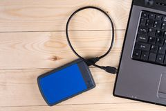 Flat lay above lap top computer keyboard and external hard disc with copy space.  royalty free stock image