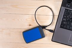 Flat lay above lap top computer keyboard and external hard disc with copy space.  royalty free stock photo
