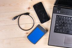 Flat lay above lap top computer keyboard and external hard disc and mobile phone with copy space.  royalty free stock photos