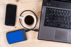 Flat lay above lap top computer keyboard with external usb hard disc hdd and mobile phone and cup of coffee, business concept Stock Photos