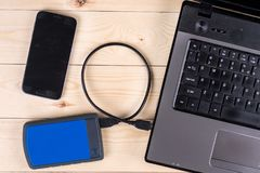 Flat lay above lap top computer keyboard with external usb hard disc hdd and mobile phone Royalty Free Stock Photo