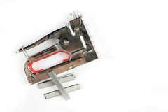 Flat lay above metal furniture stapler isolated on the white background Royalty Free Stock Photography