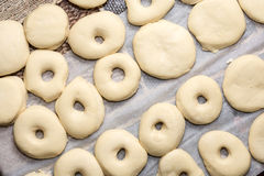 Flat lay above raw donuts dough ready for frying Stock Image