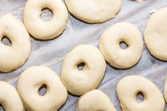Flat lay above raw homemade domestic donuts dough ready for frying Royalty Free Stock Photos