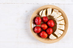 Flat lay above strawberries with sliced banana.  Royalty Free Stock Photo