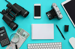 Flat lay of accessories on blue desk background Royalty Free Stock Image