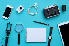 Flat lay of accessories on blue desk background Royalty Free Stock Photos