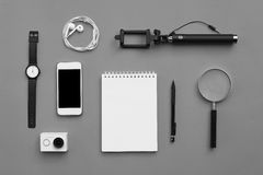 Flat lay of accessories on gray desk background Stock Images
