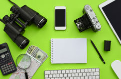 Flat lay of accessories on green desk background Royalty Free Stock Photos