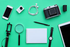 Flat lay of accessories on green desk background Royalty Free Stock Images