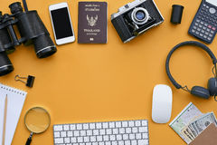 Flat lay of accessories on orange desk background Royalty Free Stock Photo